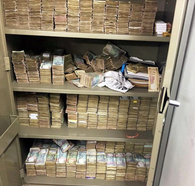 New Delhi : Stacks of currency notes that was found at Rohit Tandon's Greater Kailash residence during a raid by Delhi Police crime branch on Saturday night. Cash worth Rs 13.65 cr, including at least Rs 2.61 cr in new Rs 2,000 currency notes were recovered.