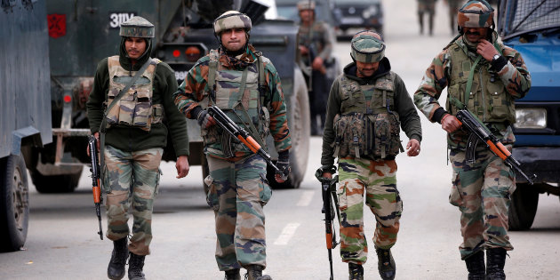 Indian army soldiers patrol a street near a site of a gunbattle between Indian security forces and suspected militants in Khudwani village of South Kashmir's Kulgam district, April 11, 2018. REUTERS/Danish Ismail